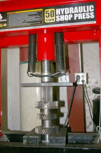 Pressing the 5-6 synchronizer hub onto the main shaft with a 50 ton press.