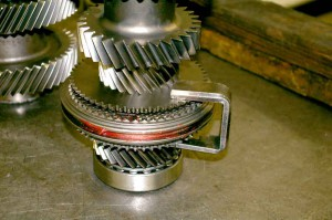 The U-shaped clamp shown is being used for assembly of 5th and 6th gears.