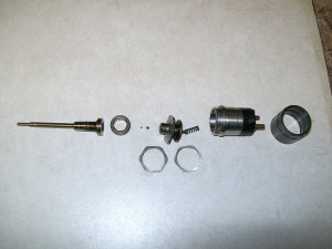 72i17. Disassembled top half of HPCR injector.
