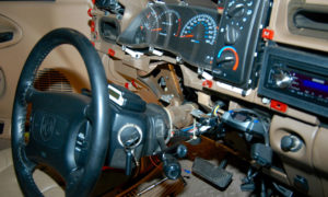 Steering column resting on seat.